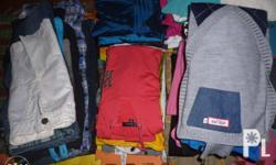 Assorted brand new and preloved clothing items for