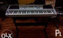 electronic keyboard seldom used still with original