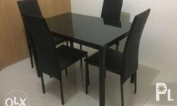 Black dining table set Top is tempered glass, frame is