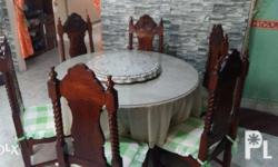 one round dinning table with glass center top and 6