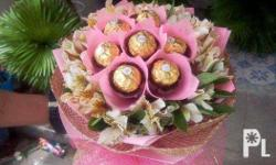 flowers and ferrero bouquet arrangements for your loved