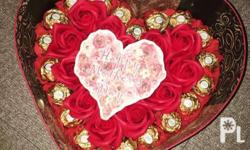 Flowers and Ferrero bouquet in a box