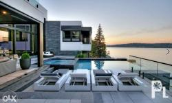 The outdoor living room�s covered lounge area is