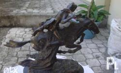 this is a bronze frederic remington bronze statue on
