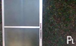 Slightly Used 74 x 186 cm Smoke Glass Door. framed with