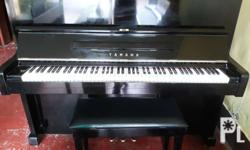 Properly restored genuine Yamaha upright piano. All