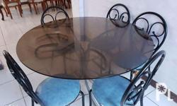 Durable glass table and six pcs steel chairs..in good