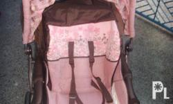 Pink/Brown colored Graco Stroller for sale. Condition: