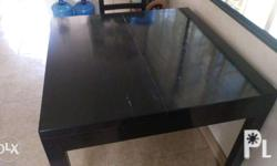"Massive table made from good wood, shiny black 38"" x"
