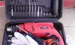 Brandnew, 13mm drill size, 650watts, with case and
