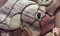 The technique of intarsia inlays sections of wood (at