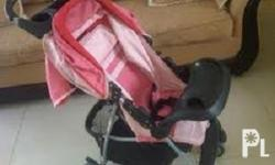 Juniors pink baby stroller in good condition for sale