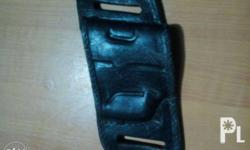 Made of leather. With strap for belt. Fits 9mm or 45