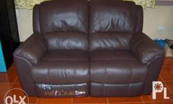 This is a like new Loveseat Chocolate Brown Leather.
