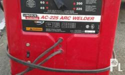 Lincoln arc welding machine: 220 Volts, 225 Amperes,
