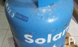 Solane LPG gas tank with snap on regulator.
