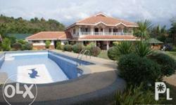 Beach Front House with swimming pool, large lawn. With