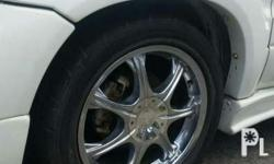 Stainless chrome mags 90% good running tires 215/70R16