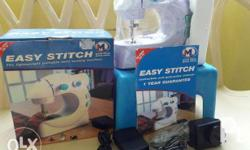 Mini sewing machine Complete set of accesories. Never