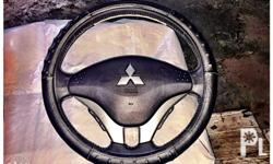 steering wheel with audio controls and air bag