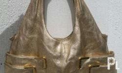 For sale original slightly used MK women medium Gold