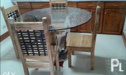 its a 4 seater narra and kamagong dining set with a