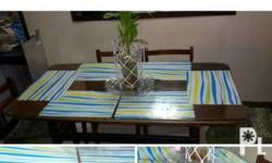Narra table with glass on top and 6 chairs You can