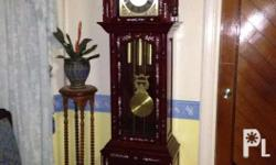 grandfathers clock made in narra wood in very good