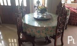 I'm selling our Narra Round Dining Table It has six