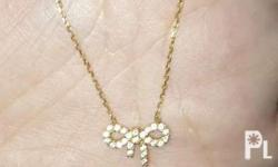 18k japan necklace with ribbon design. 17 inches. Meet