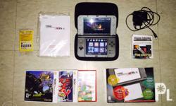 New Nintendo 3ds XL (Black) with USB charger and 3 game