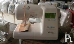 Singer Mini portable is 13 stitches with buttonholer in
