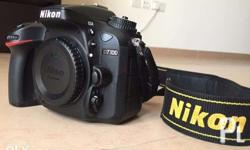 nikon d7100 dslr with strap. bodycap. charger.battery.