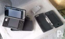 Nintendo 3DSJapanese version with silicon cover stand