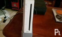 package, nintendo wii with manual ,box and 5 games and
