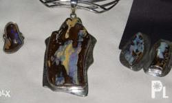 This Australian Boulder Opal set includes a large firey