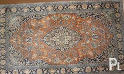 This silk rug is approximately 160x90cm. It's in Very