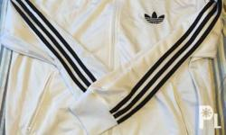 Brand new white with black stripes. Original and