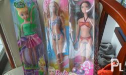 These are original Barbie dolls, Barbie and Disney's