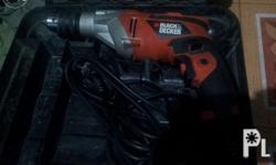 Black and Decker electric drill with hammer