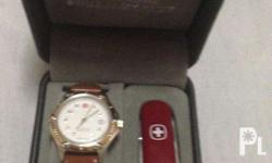 I'm selling a brand NEW WRENGLER SWISS WATCH with free