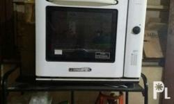 Slightly used oven Brand: LA GERMANIA Stand and gas