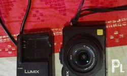 Selling my dependable Lumix LX5. I still have the box