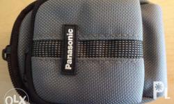 Panasonic soft grey case for digital cameras. Has belt