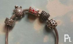 Original Pandora silver bravelet with charms