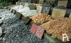 Different kinds and shapes of pebbles for sale using