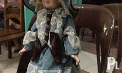 Standing porcelain doll In very good condition Can