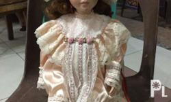 Best buy porcelain doll Peach dress In good condition