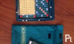 Brand new Portable Scrabble Sealed and a domino set