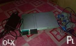 ps2 slim type with games and analog controller good